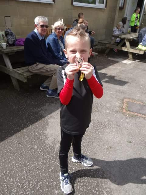 Alex with his medal.
