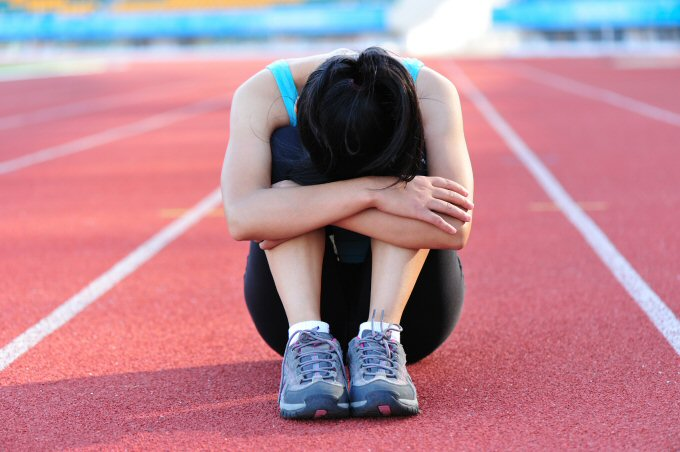 Athlete holding knees.