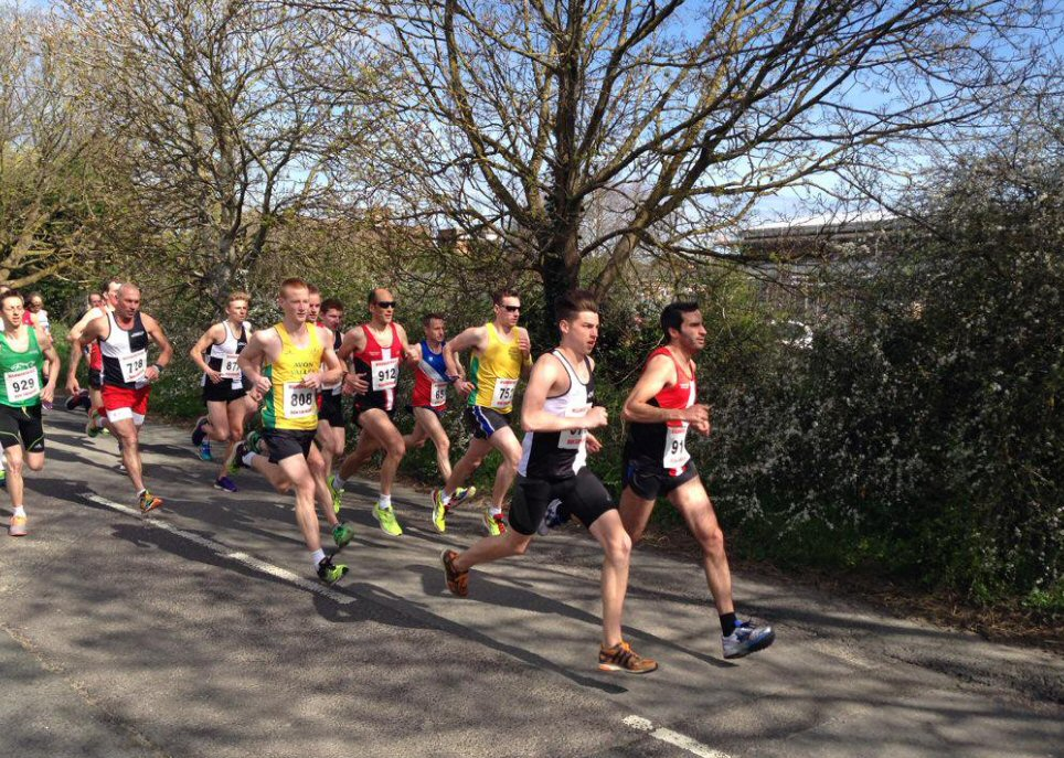 A Swindon harrier leading a road race.